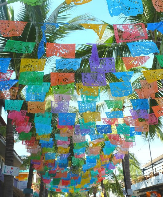 Lacy picados (decorated paper flags) hang above many streets in Sayulta