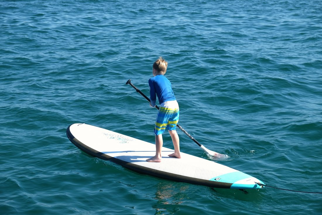 Trying stand up paddle boarding for the first time