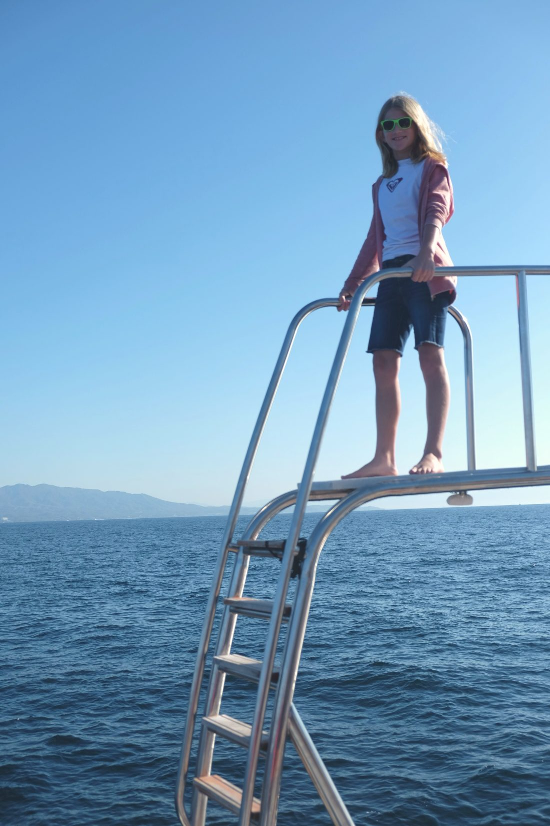 She found the perfect vantage point for spotting whales. Allycat. Punta de Mita