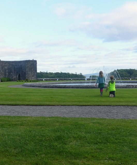 Exploring the grounds of Ashford Castle at sunset. County Mayo, Ireland