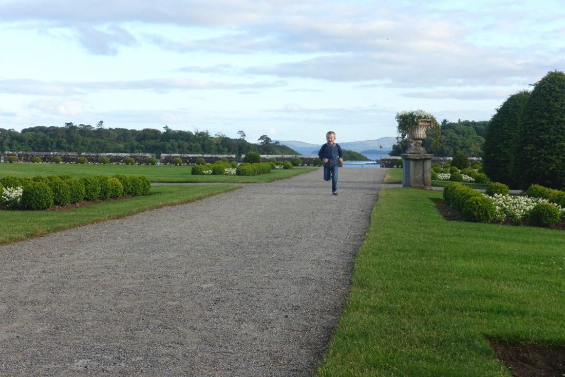 The grounds at Ashford Castle with Lough Corrib in the distance. County Mayo, Ireland