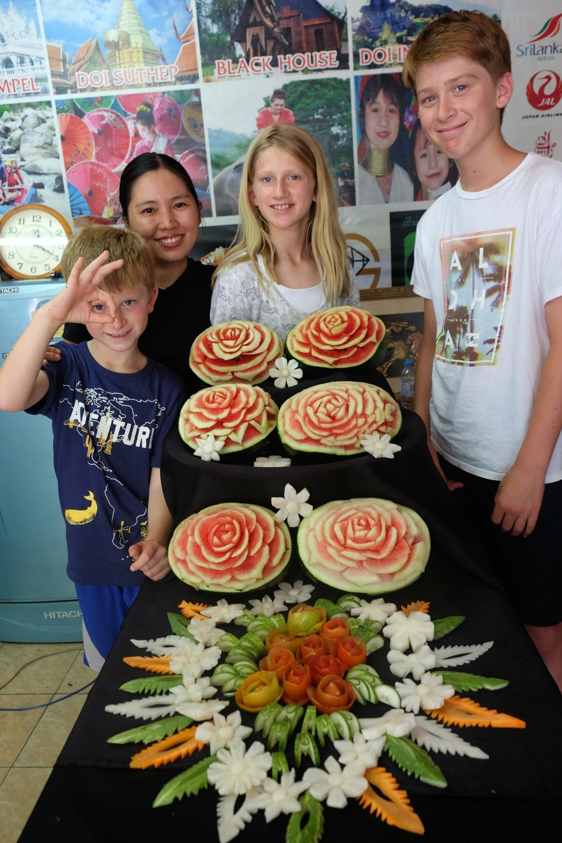 Showing off our creations with our instructor, Boom. Chiang Mai, Thailand