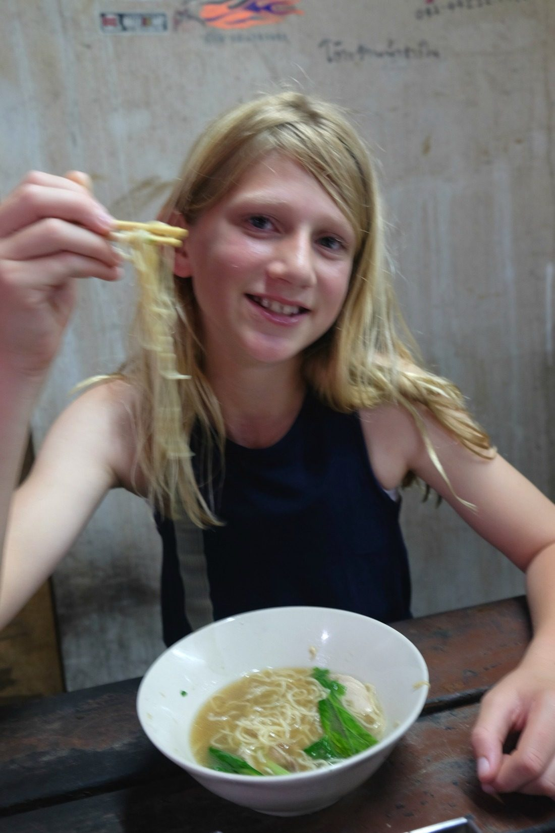 Eating noodles in a hidden alleyway we never would have found on our own!
