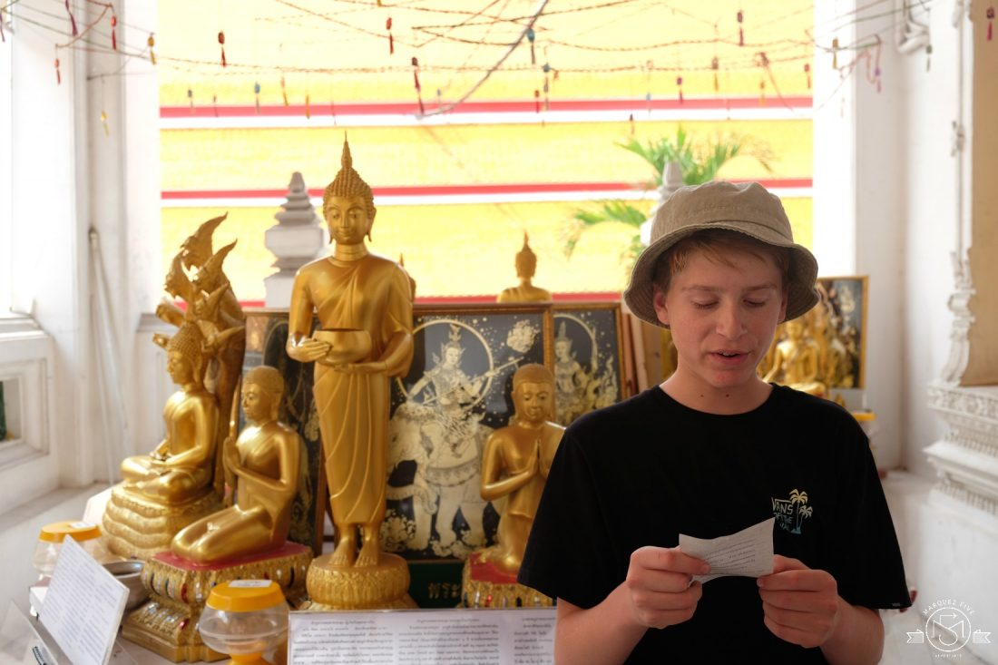 Reading out his fortune at In the courtyard at Wat Mahathat