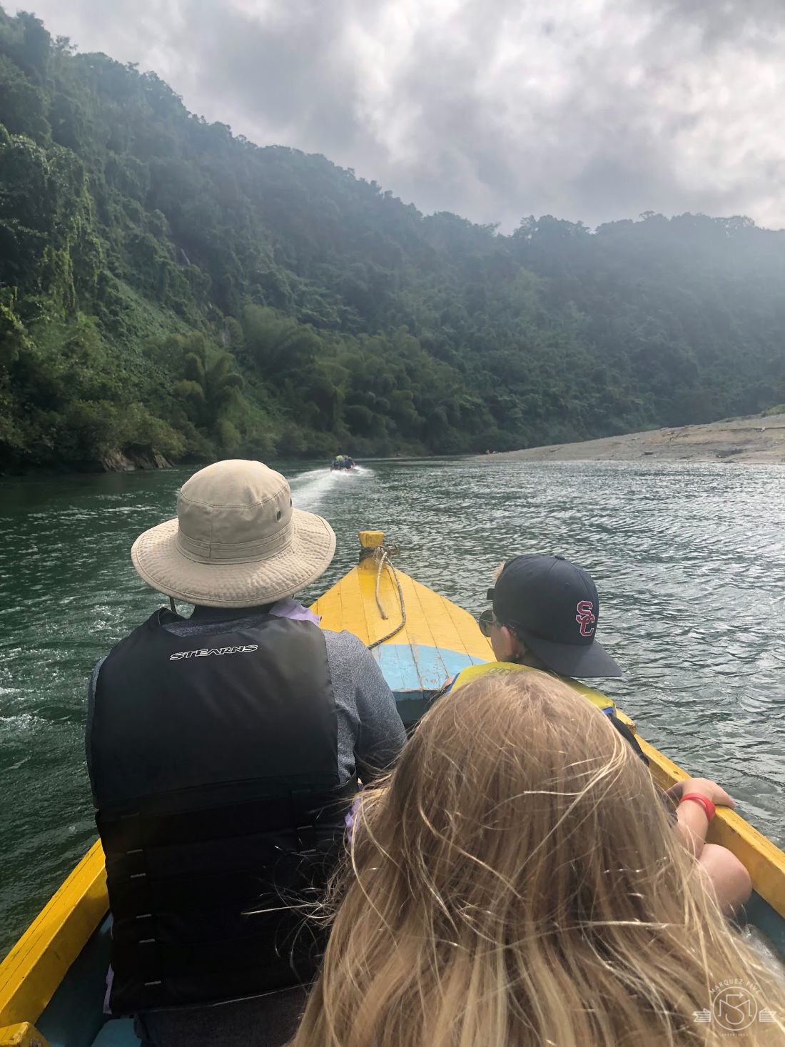 Heading up the Navua River in a longtail boat.