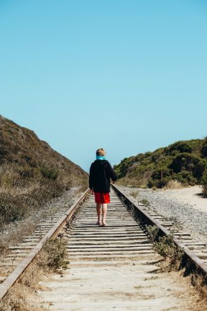 Walking along abandoned railroad tracks. Davenport, California