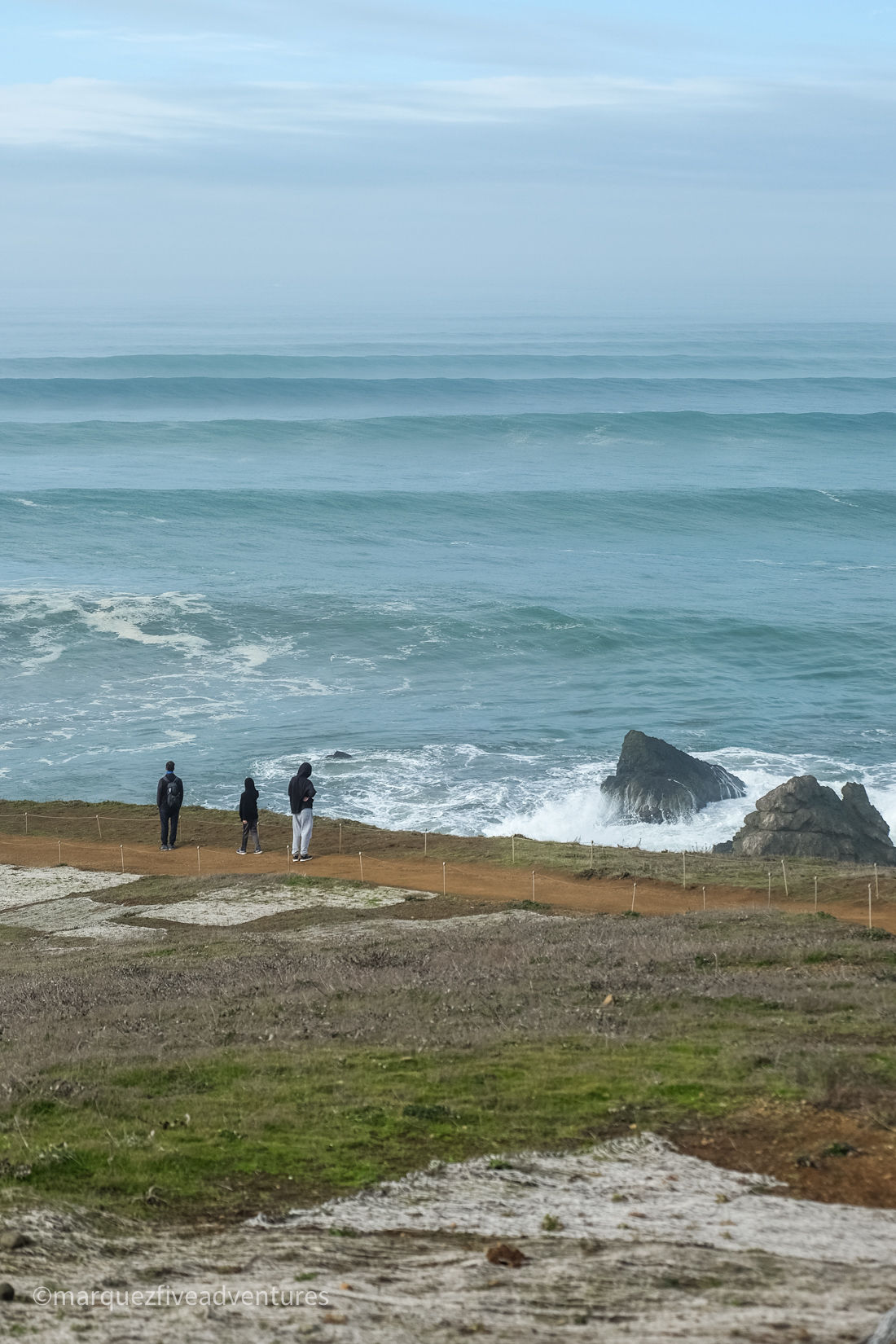 Standing at The Point, looking out at all the waves during a high surf advisory. Mori Point Trail. Pacifica, California