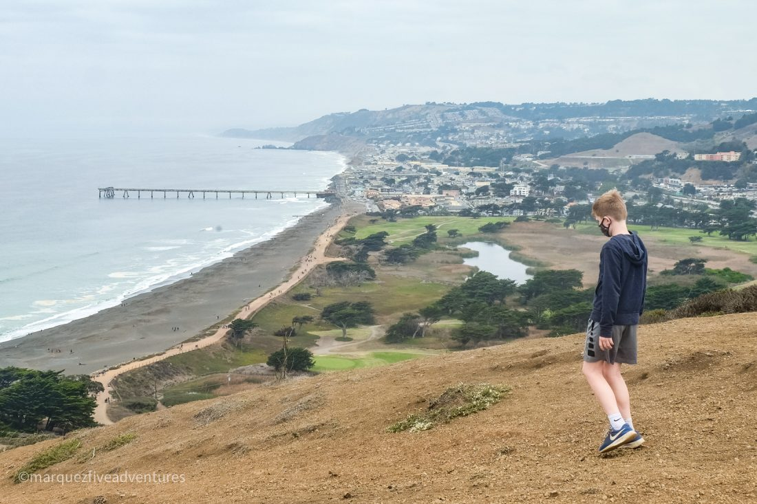At the peak, looking down towards Sharp Park Beach. Mori Point Trail. Pacifica California