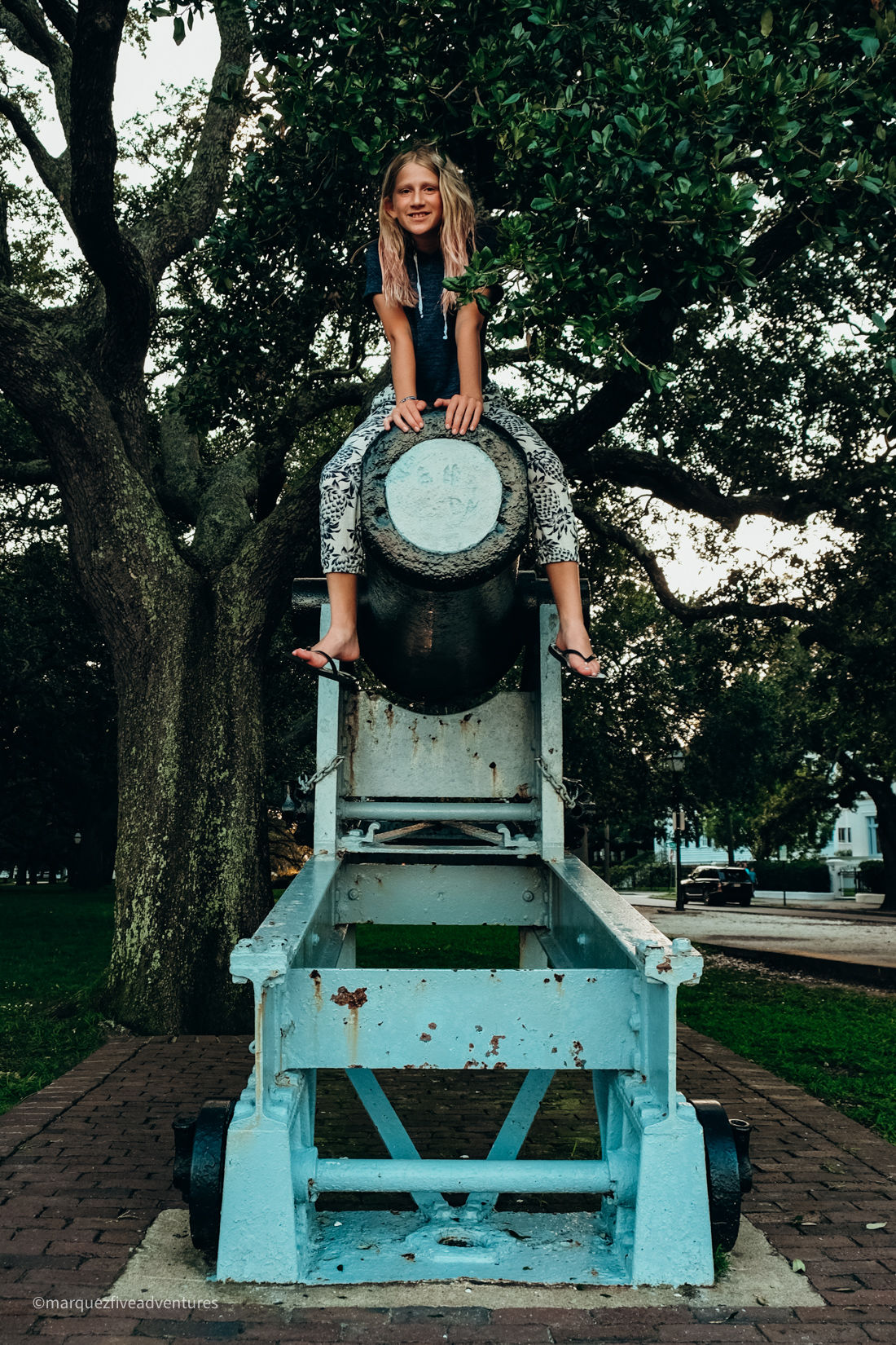 She probably wasn't supposed to climb on this...White Point Garden. Charleston, South Carolina
