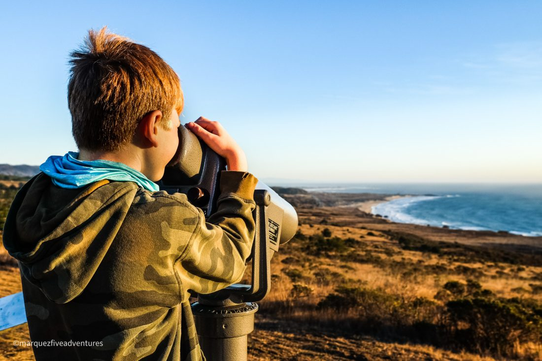 Taking advantage of the telescope to check out the views at the top of Wilbur's Watch. Pescadero, California. San Mateo County