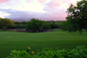 View from our backyard overlooking the golf course and mountains at sunset. Pauoa Beach Club Neighborhood. Big Island Hawaii