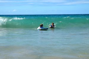 Catching waves at Hapuna Beach, Big Island, Hawaii