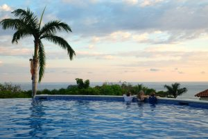 Enjoying the view of the Pacific sunset from the pool. Parador Hotel. Manuel Antonio Park, Costa Rica