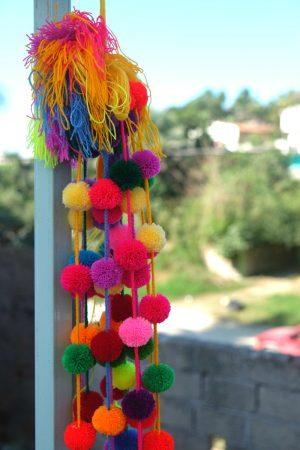 Handmade pom poms. Human Connections, Bucieras Mexico
