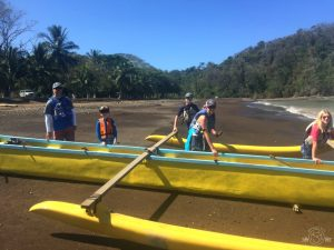Pushing the outrigger into the water