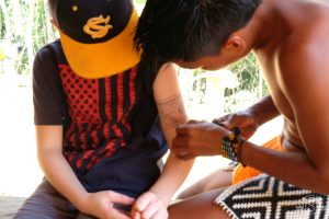 Getting a tattoo by a member of the Embera Tribe
