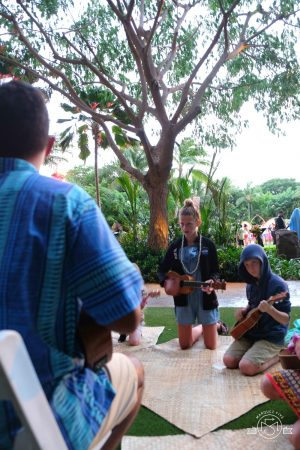 Learning to play the ukulele at the Aulani Luau