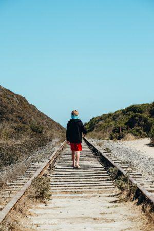 Walking along abandoned railroad tracks. Davenport, California