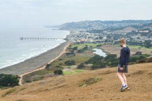 At the peak, looking down towards Sharp Park Beach. Mori Point Trail. Pacifica California