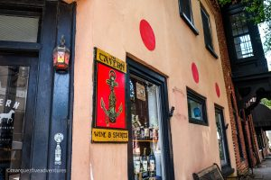 3 Red Dots on a storefront in South Carolina means the establishment sells liquor. Charleston, South Carolina
