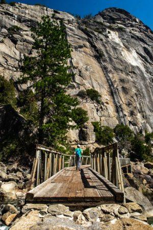 Crossing the bridge over Wapama Falls. Yosemite National Park. Hetch Hetchy.